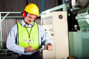 Working safely with ear defenders and hard hat protection