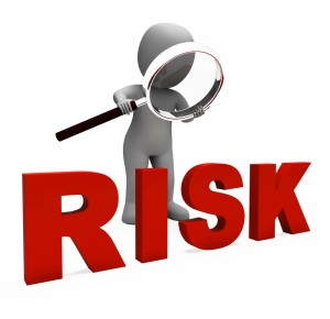 cartoon character with magnifying glass over the word RISK