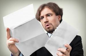 shocked man reading paper