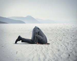 Man with head in the sand