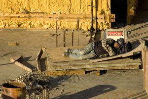 Man asleep on construction site
