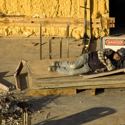 Man asleep on construction site