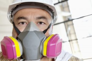 Construction worker in dust mask